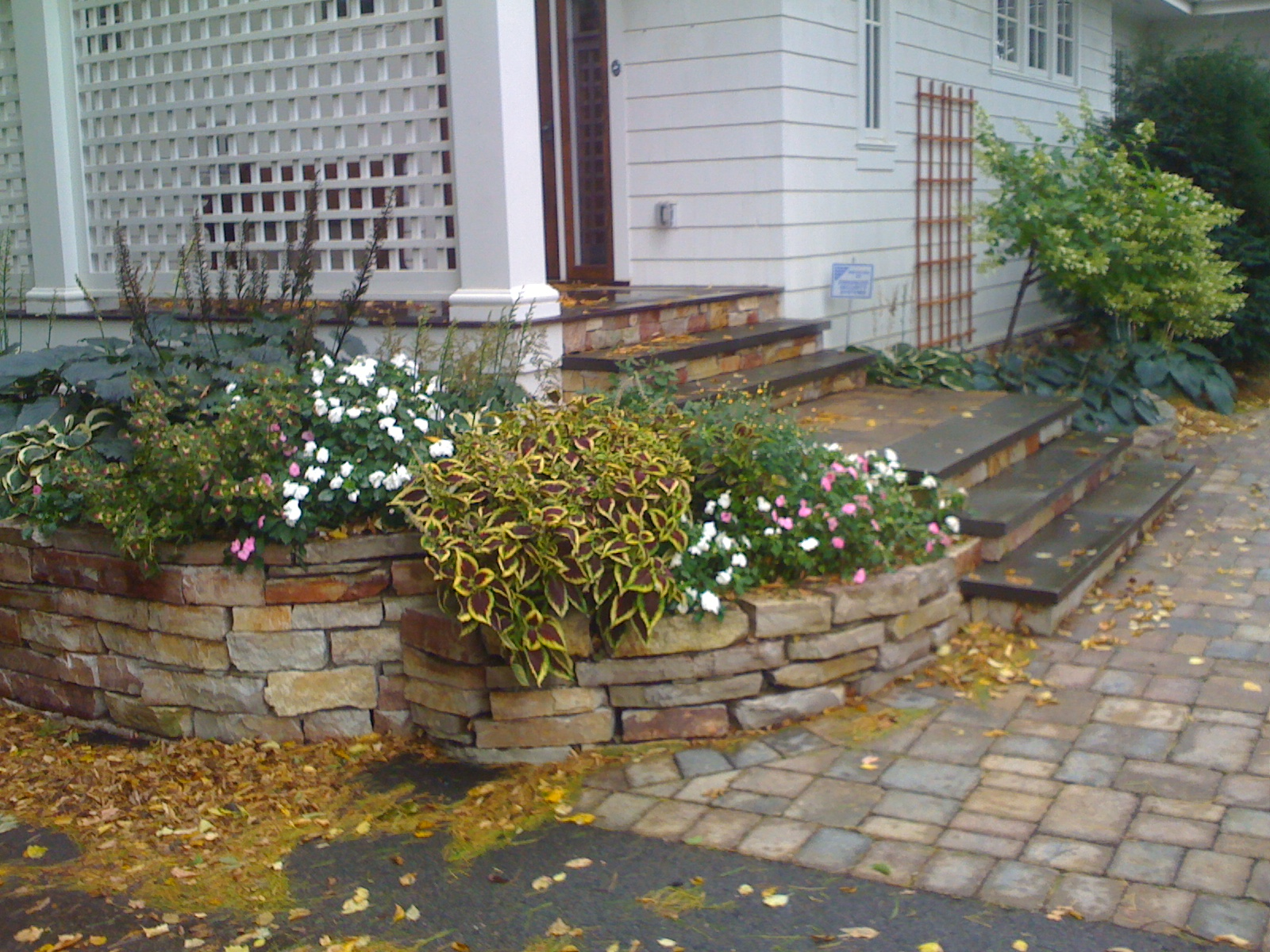 Outdoor Stone Steps With Walkway And Stone Retaining Wall Harold J