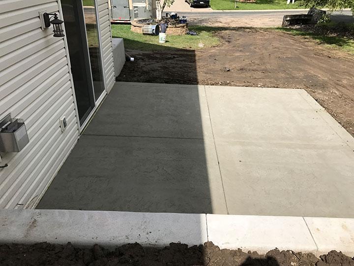 Poured Concrete Retaining Wall And Concrete Patio In Minneapolis Mn