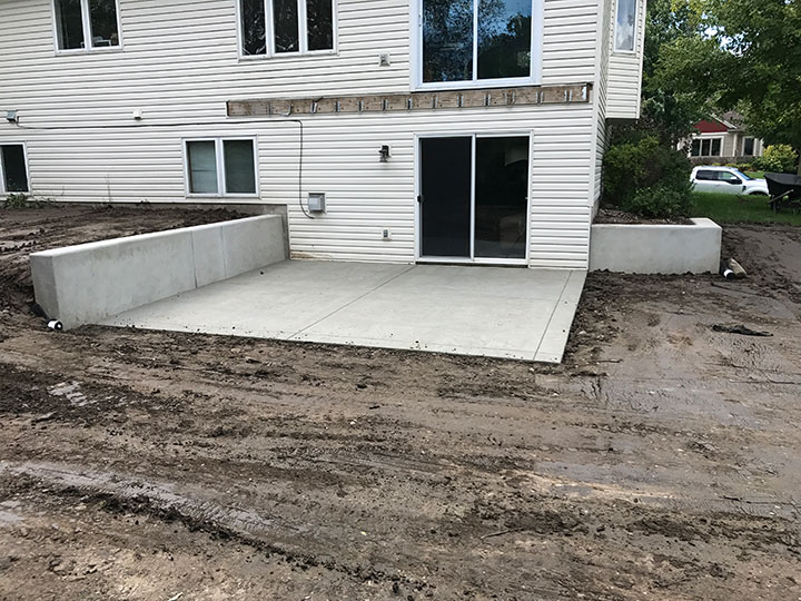Poured Concrete Retaining Wall And Concrete Patio In